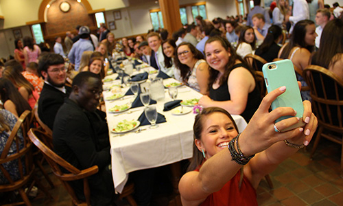 student takes a selfie in davison dining hall