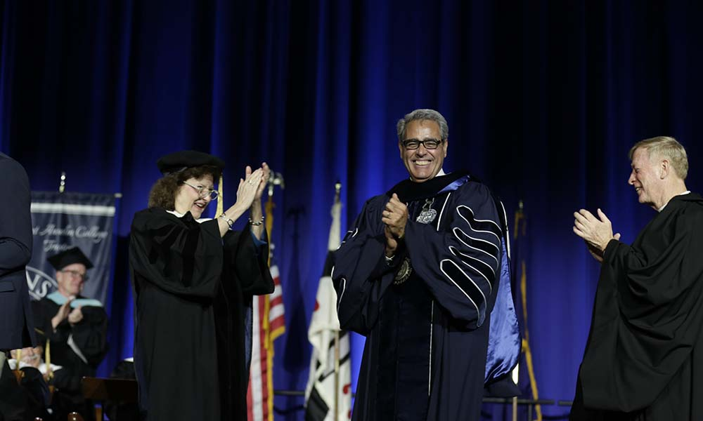 Dr. Favazza celebrating during the installation ceremony