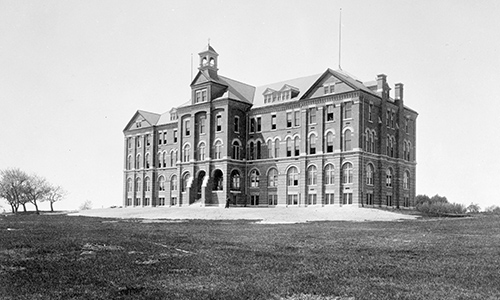 black and white old photo of alumni hall