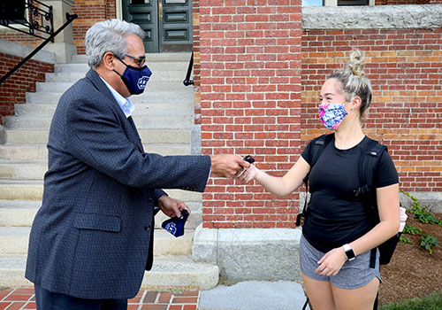 Dr. Favazza exchanging masks with a student