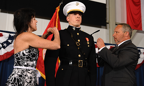 Graduate Tyler Guilmette being pinned at his commissioning into the U.S. Marines