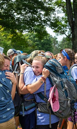 students hugging upon arrival from road for hope