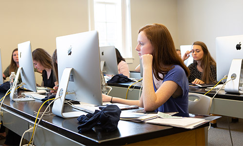 students sitting at desktop computers